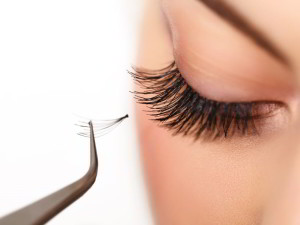 applying lash extension by Tool Box Makeup